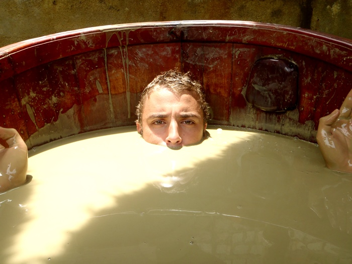 3. Soaking in Mud