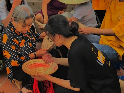 sewing Vietnamese conical hat